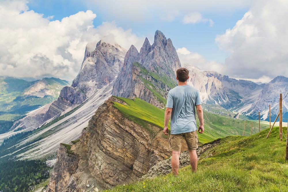 Persona en una montaña - Huella Ecológica